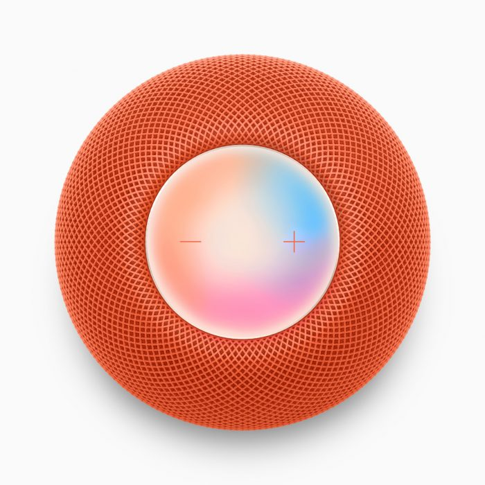The top touch surface of the HomePod mini in orange with volume icons